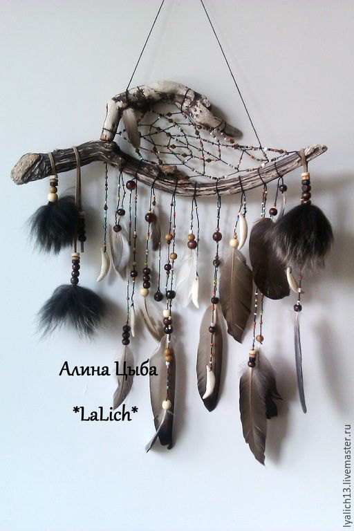 DREAMCATCHER: Deer antler, feathers, and chunks of fur. Love the beadwork!