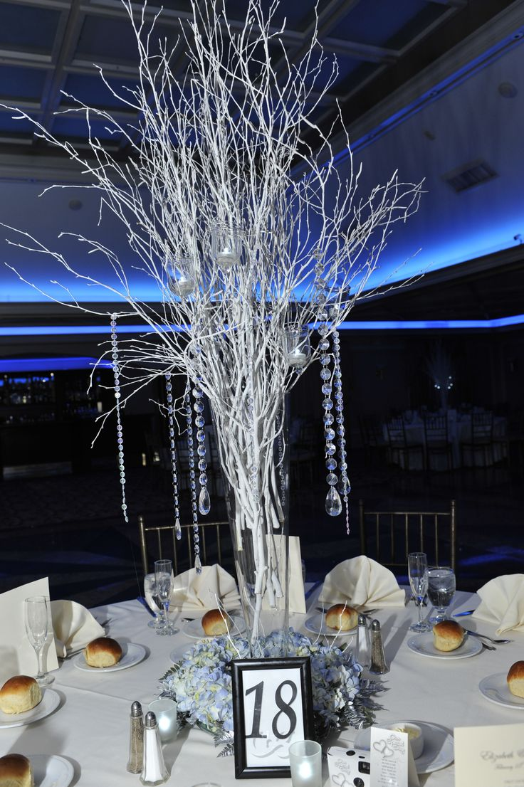 Winter centerpieces our winter wonderland wedding for Winter themed wedding centerpieces