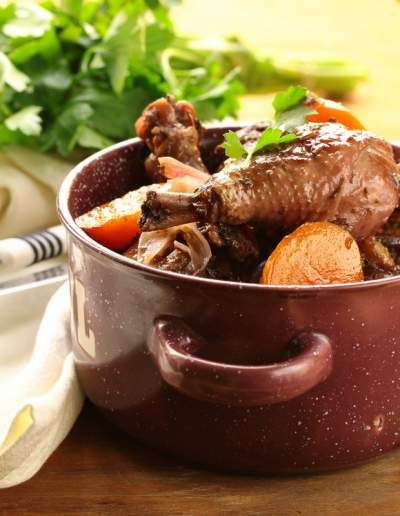 Various legends trace coq au vin to ancient Gaul and Julius Caesar, but the recipe was not documented until the early 20th century.