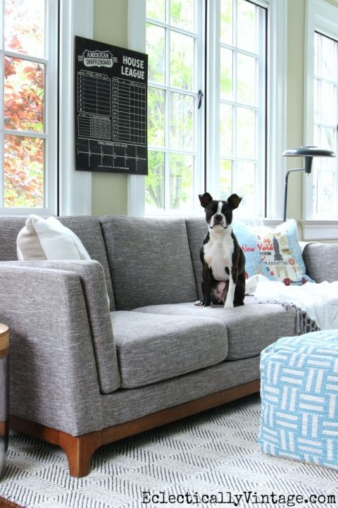 Love gray sofas - they are the perfect neutral backdrop for fun patterns and colors from rugs, poufs, throws and pillows like these fun ones from HomeGoods eclecticallyvintage.com sponsored pin