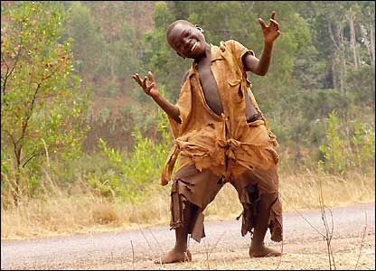 Laughing dancing Burundi child- happy tho poor. Silly idea ...