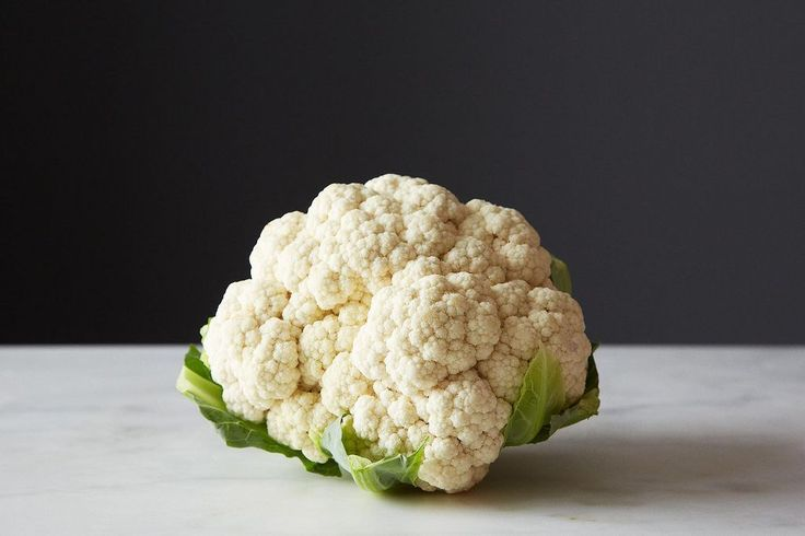 Set any suspicions aside: The ring of green leaves around your head of cauliflower deserved to be eaten—in this risotto.