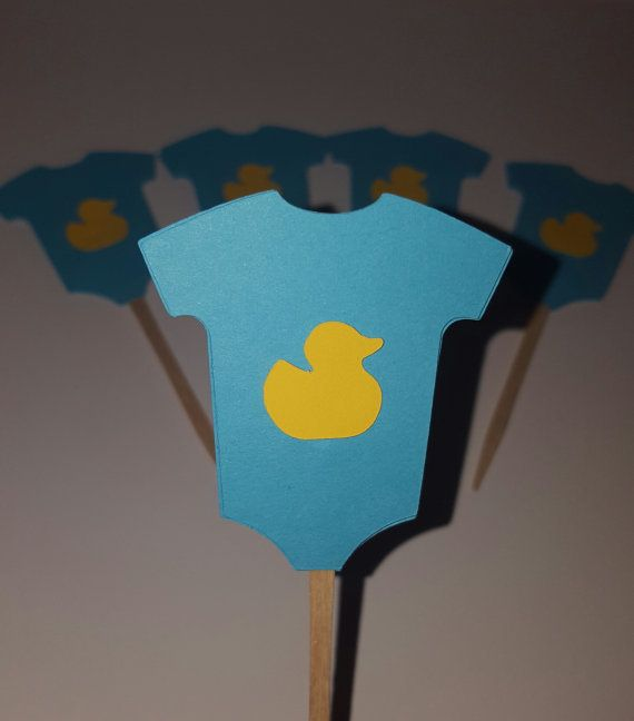 Check out this item in my Etsy shop https://www.etsy.com/listing/272192608/baby-onesie-cupcake-or-cake-toppers-for
