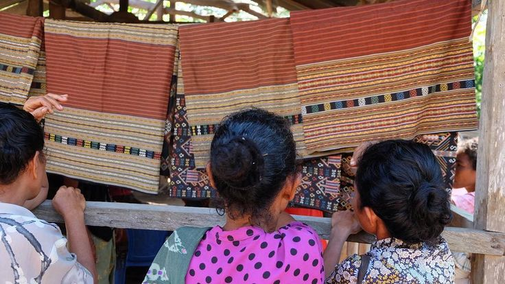Women inspecting buna textiles brought down from the mountains in Bokong.#naturaldye #threadsoflife