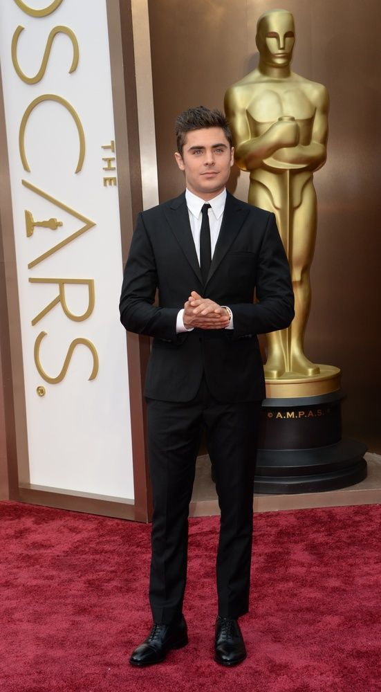 Hope that wasn't awkward! Zac Efron wears Calvin Klein and shoes by Johnston & Murphy, just like JGLevitt on the 2014 Oscars Red Carpet