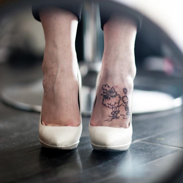 Poodle tattoo