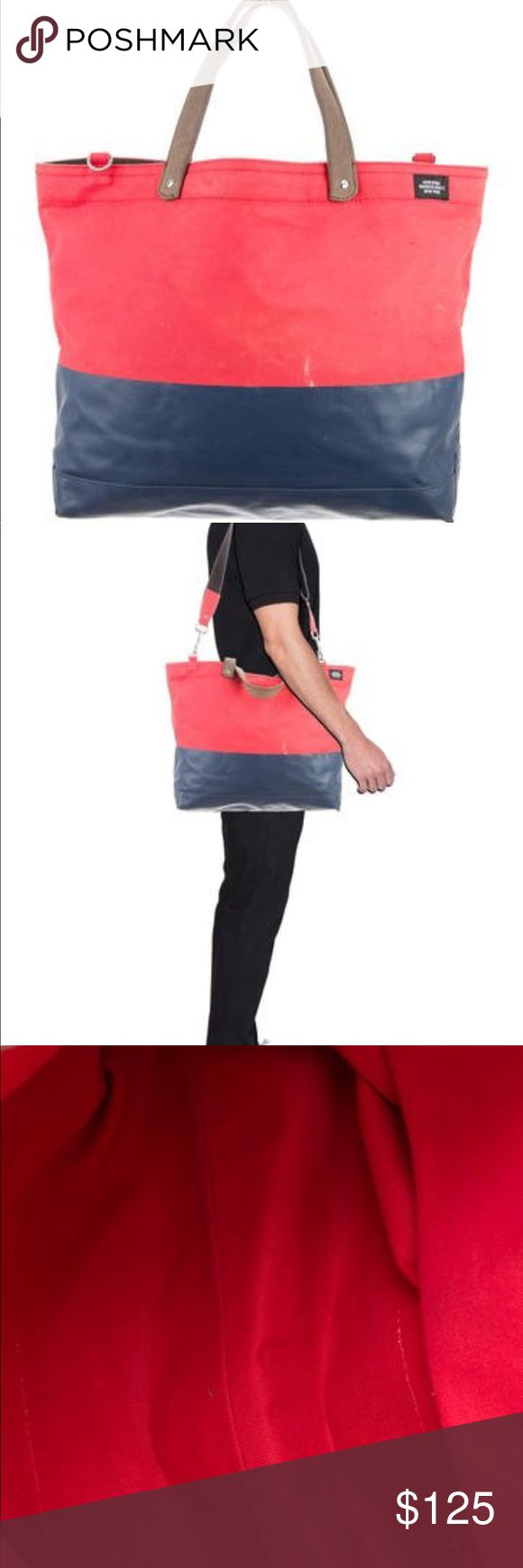 Jack Spade Bag Jack Spade Red Canvas with coated blue canvas bag. In good Condition. Some marks as seen in photos. Comes with shoulder strap. Great for the beach or a weekend trip. Look fresh with this on your side. Jack Spade Bags Luggage & Travel Bags