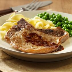Thin cut bone-in pork chops cook quickly in a skillet and then are drizzled with a warm honey-mustard sauce