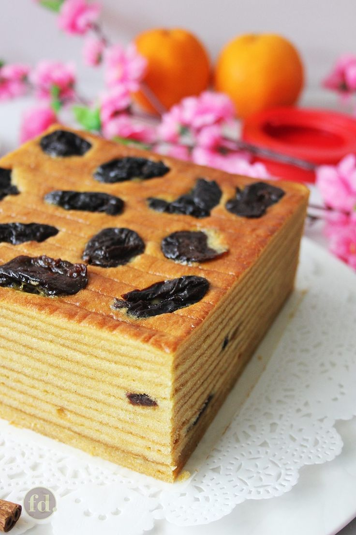 Indonesian layer cakes are decadently moist, gloriously buttery and wonderfully aromatic. These layered butter cakes are loved for their richly sweet and spiced-infused flavours, and often tinged with dashes of liquor - rum or brandy being the usual favourites! Here, these cakes are given a fresh twist by layering dried fruit, such as dried prunes, in between the many layers.