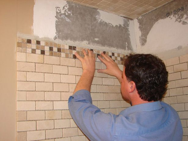 How to Install Tile in a Bathroom Shower - this suggests that you can get a professional for specific steps and do the rest yourself.