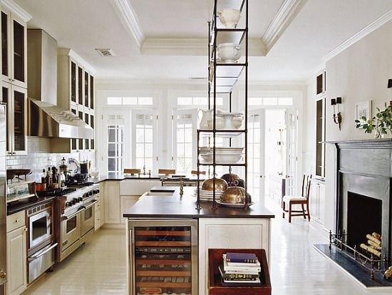 Open shelving on the island offers more storage & display for favorite dishes & such without obstructing your view or closing in the area. Great use of space. Beautiful kitchen.