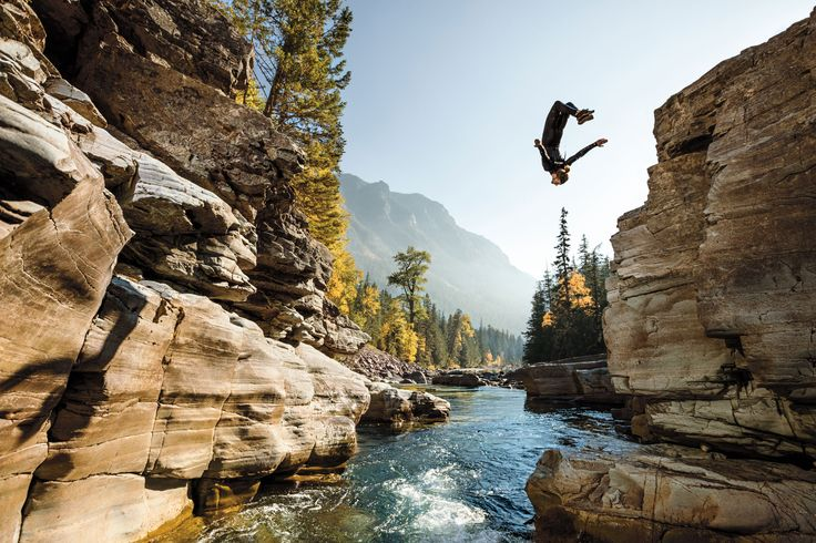 Picture of Steven Donovan flipping into a pool in Glacier National Park