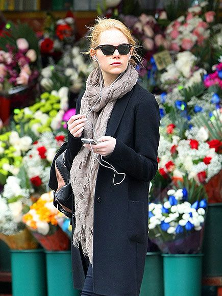 Following a day date with boyfriend Andrew Garfield, Emma Stone steps out solo in N.Y.C. Wednesday, keeping company with her tunes.