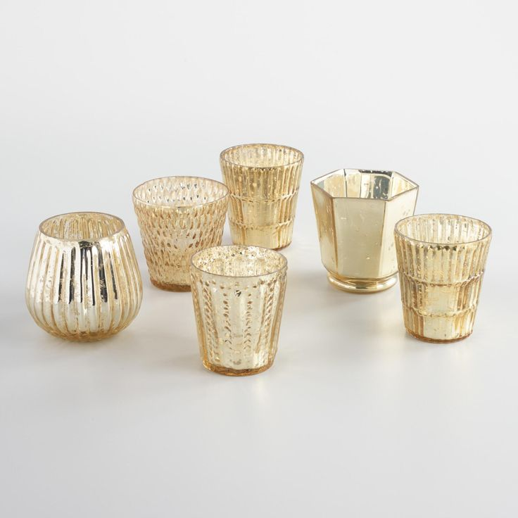 With six different designs in a vintage-inspired gold hue, our sophisticated mercury glass candleholders create a festive atmosphere grouped together or displayed on tabletops throughout your home.