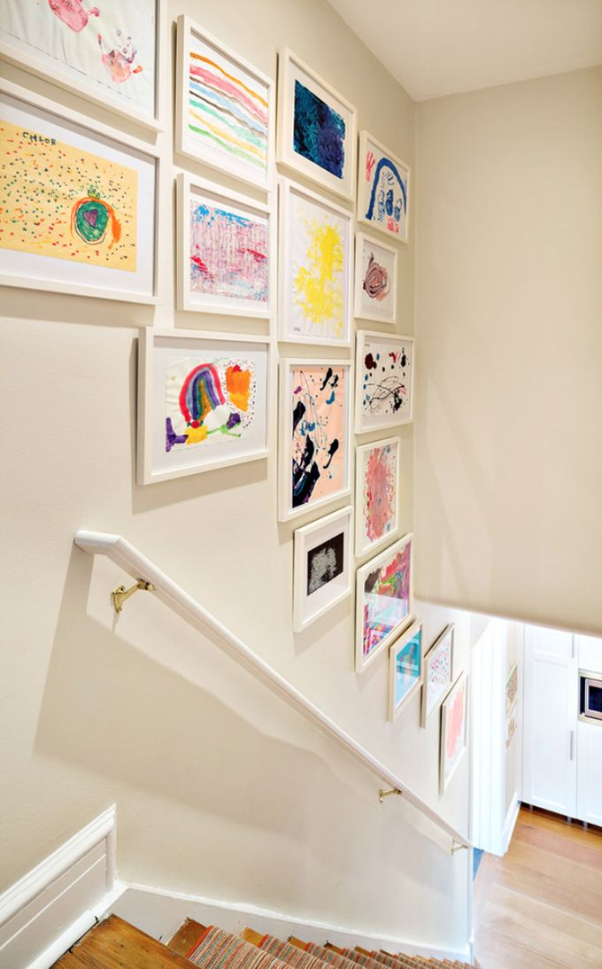 Proudly display your framed kids' artwork in the stairwell. Such whimsical and sentimental wall decor.