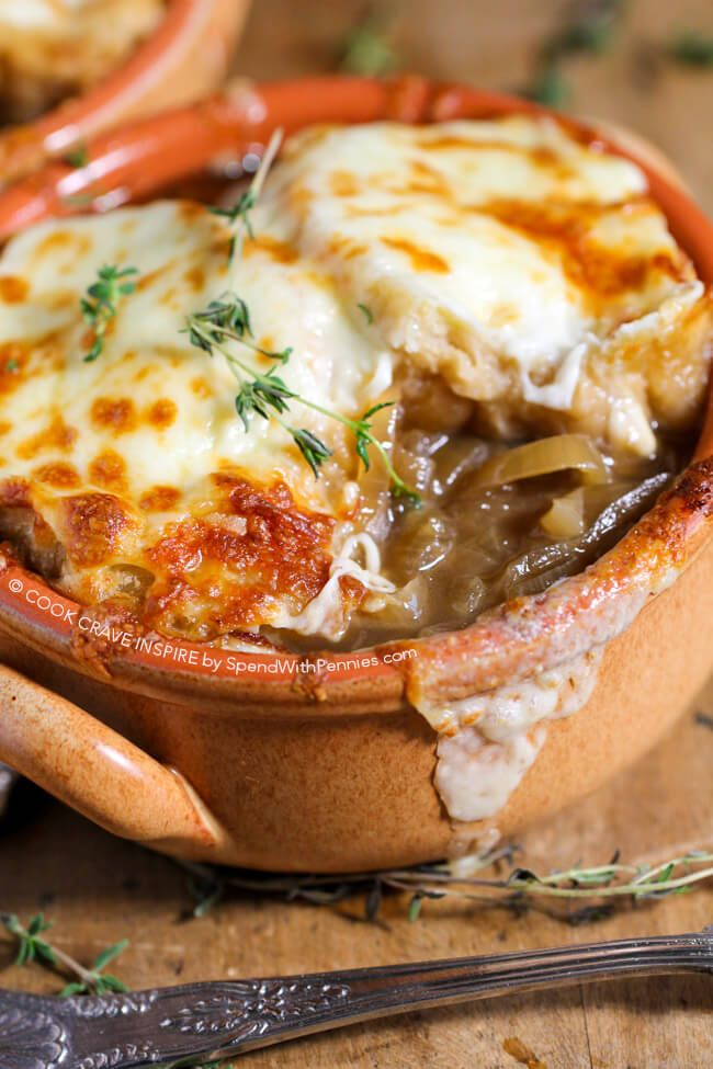 Slow Cooker French Onion Soup has a rich beefy broth loaded with caramelized onions and herbs and topped with an amazing Gruyere cheese topping!