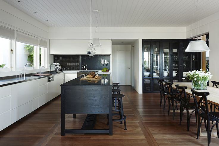 The amazing work of Sarah Davison in this classic and sophisticated kitchen dining space. We love the dark floating bench and simple lines with white cabinetry and detailed timber floors. High glamour!