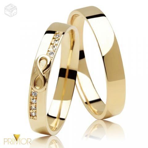 Par de Alianças em ouro simbolo infinito 8g AL049