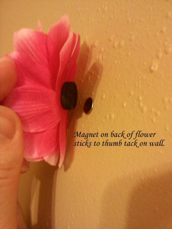A thumb tack in the wall and a magnet glued to whatever you want to decorate with! GENIUS.