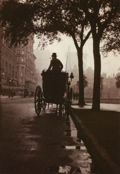 Captivatingly wonderful image of a lone carriage driver on a rain slicked road, taken in Central Park, New York, c. 1900.