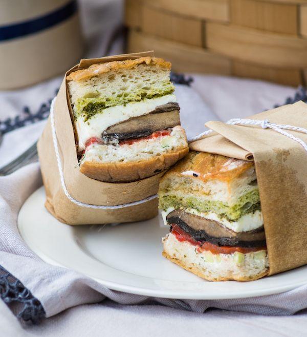 Pressed sandwich with marinated portobello caps, roasted red pepper, fresh mozzarella with Pesto and Tzatziki. Perfect for a picnic!  Full recipe