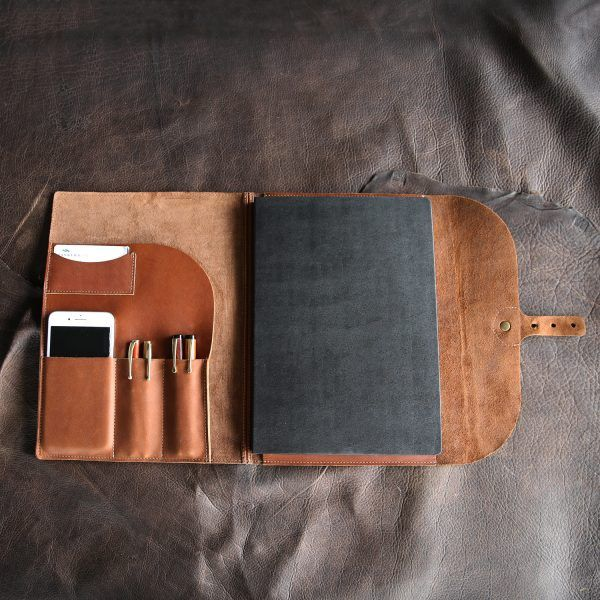 Love this!! Great gift for an artist/ writer. The Artisan Fine Leather Moleskin Journal with Grid Paper Holtz Leather Co.