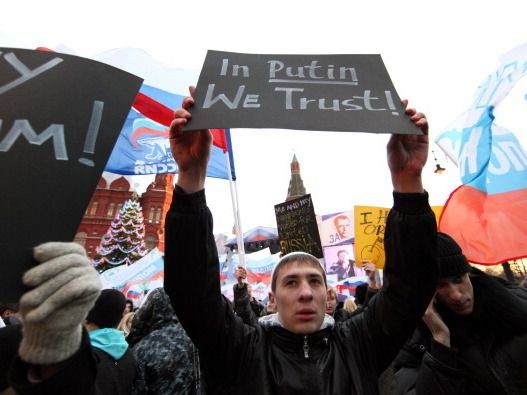 Activists from the Young Guard, which supports Russian President Vladimir Putin…