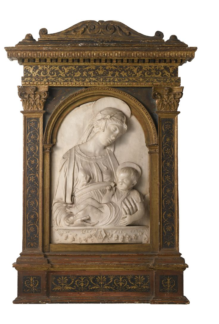AN ITALIAN MARBLE RELIEF OF THE MADONNA AND CHILD, AFTER A COMPOSITION BY THE MASTER OF THE PICCOLOMINI MADONNA, 19TH CENTURY