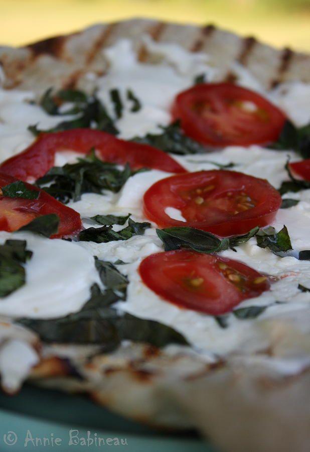 Grilled pizza with fresh mozzarella sliced tomato fresh basil