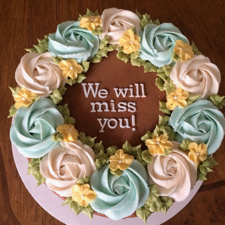 Quick and easy chocolate buttercream farewell/ going away cake for a coworker. Prepared rosettes (Wilton 1m tip) in advance and stored them in the freezer (made them easier to add to cake). Added leaves to fill in gaps (Wilton 352 tip). Letters made from FMM tappits.