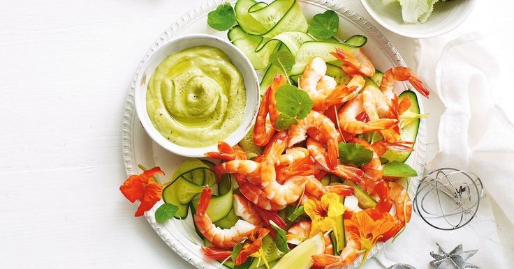 """This recipe is a fun take on the classic prawn cocktail. I've given the usual Marie Rose sauce a green twist by using avocado instead of cream or mayonnaise, making it both dairy and egg free. This is one of my summertime faves and is perfect as a shared appetiser or placed in the middle of the tab"