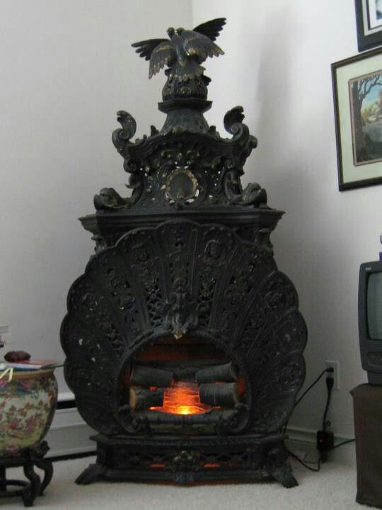 The fanned out shield on the front looks like a Peacock to me....Old Stove...beautiful.