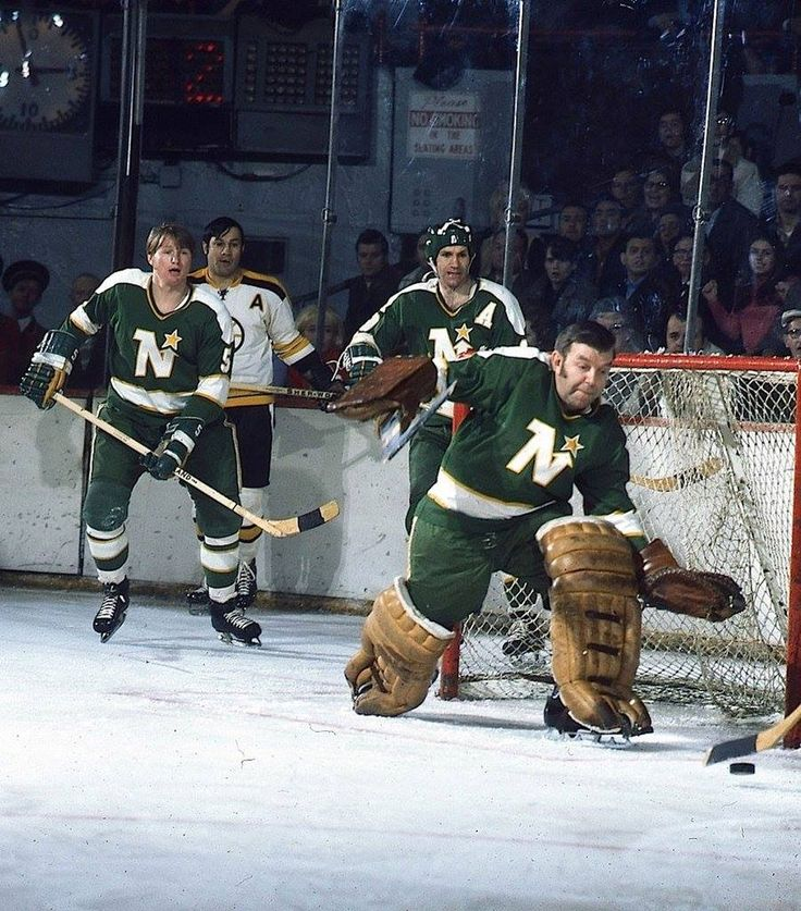 Gump Worsley in net, Dennis O'Brien and Charlie Burns for the North Stars, Johnny Bucyk for the Bruins.