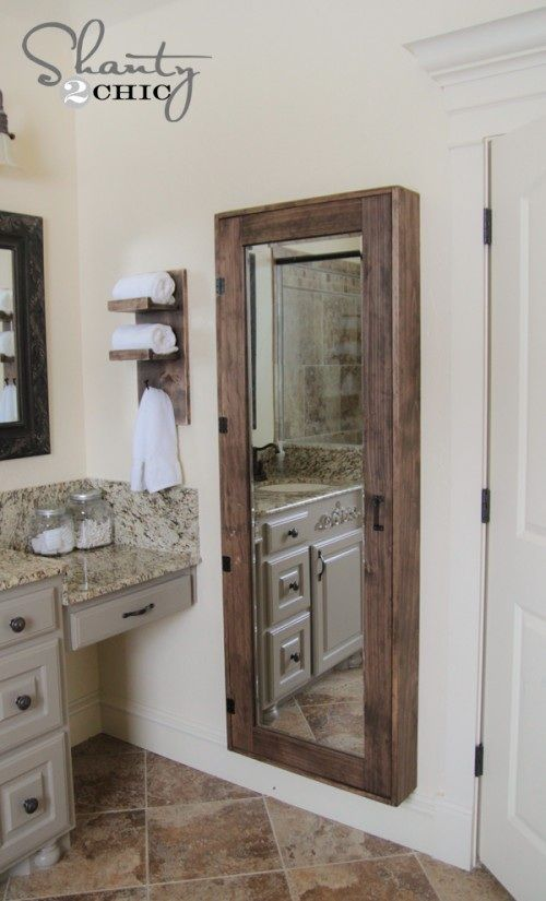 DIY Bathroom Storage Cabinet. Great for storage. I like the full length mirror. Great for doing makeup & hair