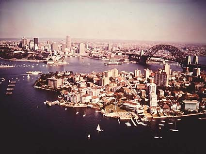 Sydney Harbour from north side with Opera House and Bridge, 1970. NAA: A1500, K25126