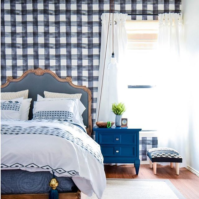 Beautiful blue gingham wall with upholstered headboard.