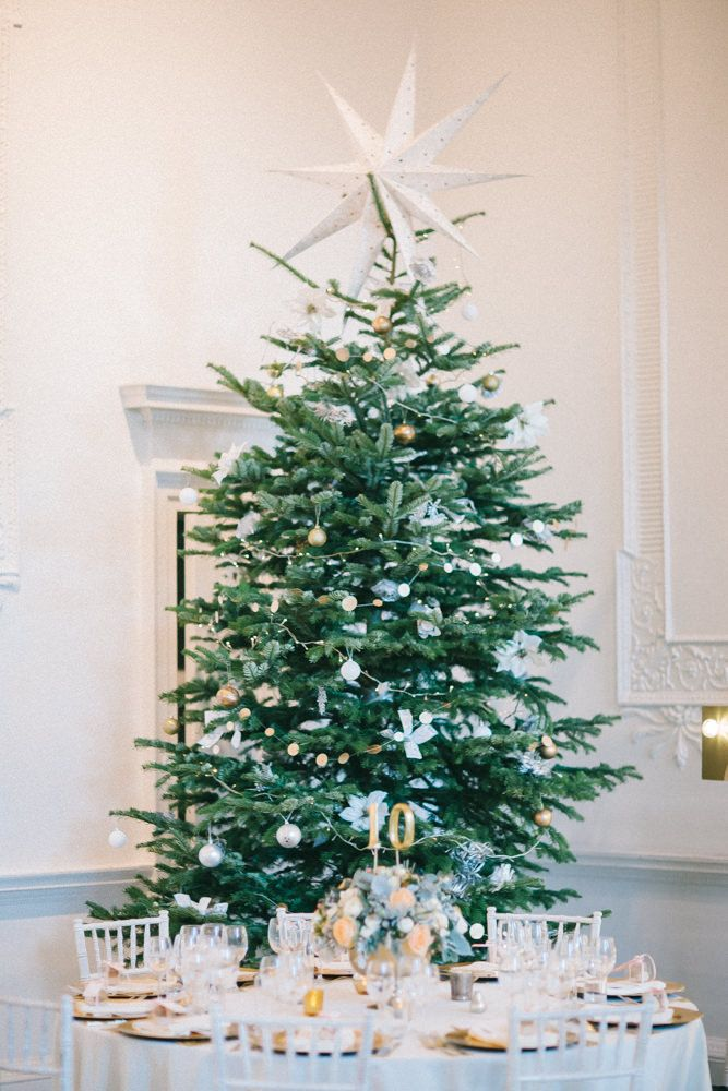 Christmas Tree at a Winter Wedding - Image by Chris Barber - Justin Alexander Wedding Dress For A Winter Wedding At Compton Verney Art Gallery With Groom In Reiss And Bridesmaids In Embellished Dresses From Miss Selfridge With Images By Chris Barber And Videography By Simon Clarke Films