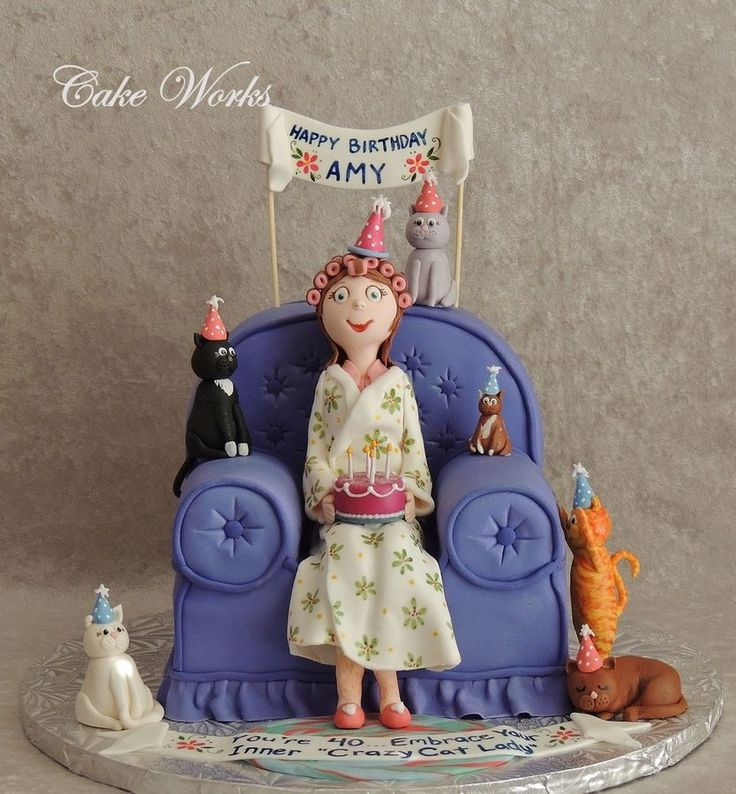 This was a fun cake for my dear sister's 40th birthday. The cake is her favorite almond poppyseed with raspberry filling. The figure and cats are both modeling chocolate and gumpaste. The robe, birthday sign and crazy cat lady message are hand painted.