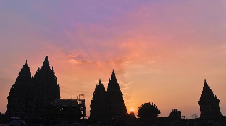 Prambanan Temple, Yogyakarta. Our favorite photo of Sunset in the collection. See as the beautifully soft mixed colors of the skyline meld with the silhouette of Prambanan Temple.