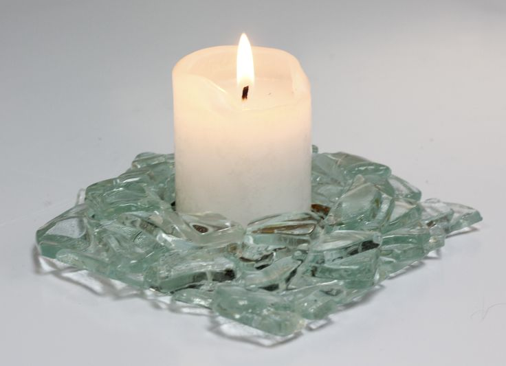 Candle holder made from shards of 5mm float arranged in a circle and a coloured frit bottom for candle insert.