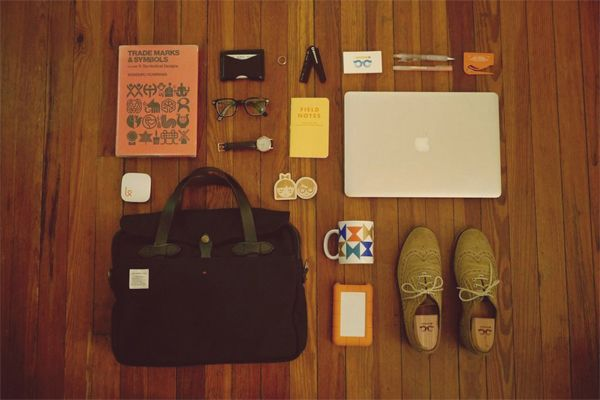 What 20 Designers Carry Inside Their Bags [PICS]
