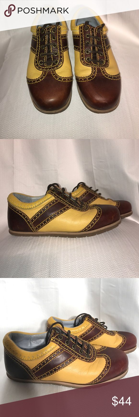 Yellow and brown leather men's saddle shoes. 7 Yellow and brown men's saddle shoes. 7. Banana yellow and dark brown leather shoes. These shoes Smell great. The leather is high quality. Great condition. Scuff on one front of shoe. Shoes Oxfords & Derbys