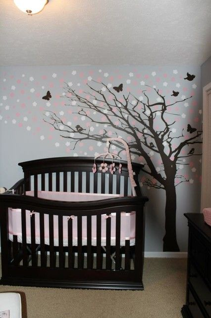 Fancy Light Grey Painted Nursery Decor Ideas for Girl Involving Black Crib to Match Tree Decal with Pink Flowers