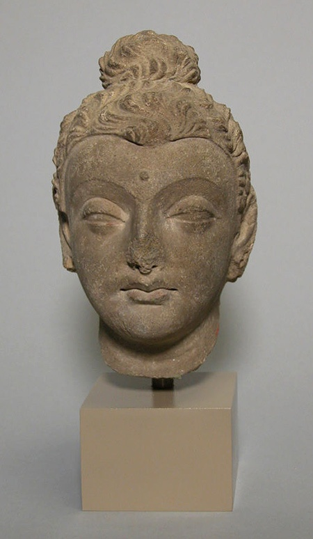 Head of Buddha, ca. 4th century. Pakistan, ancient region of Gandhara. Stucco with traces of paint.