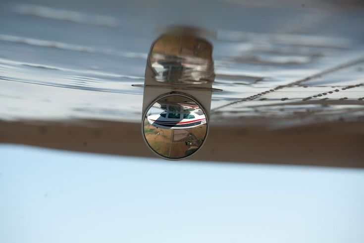 Cessna 210 Reflection from the gear-down confirmation mirror.  Great perspective.