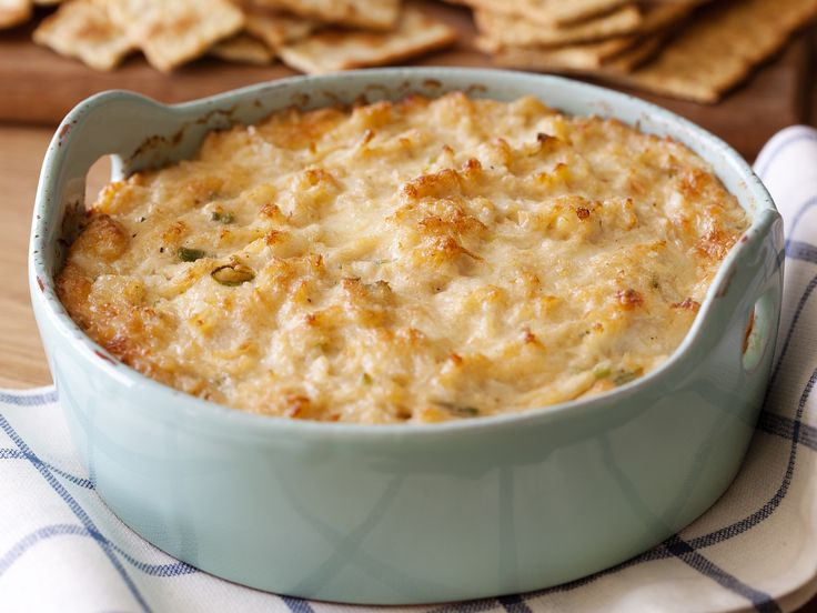 Hot Crab Dip from FoodNetwork.com   Now I'm not normally a Paula Dean acolyte, but I lost my original crab rangoon dip recipe and was thinking of subbing this for a dinner party. Thoughts?