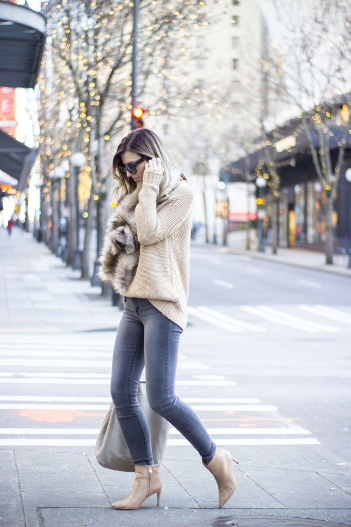 Faux fur scarves are a definite trend this winter! Brenna looks ultra stylish in this glamorous wolfskin mink, which she is wearing with a cute knit sweater and denim jeans. We love this look! Sweater: Zara, Scarf: Royal Scout & Co, Jeans: J. Brand, Bag: Cuyana, Boots: Sam Edelman.