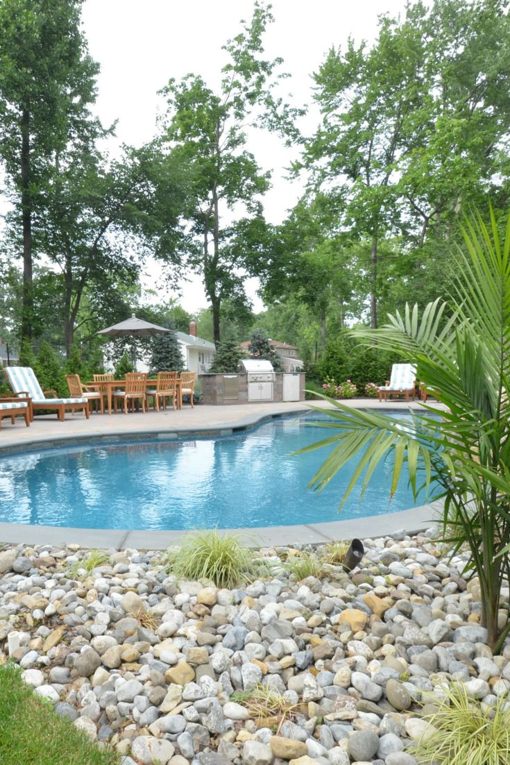 using a river rock and palm green gives this nj home a resort like