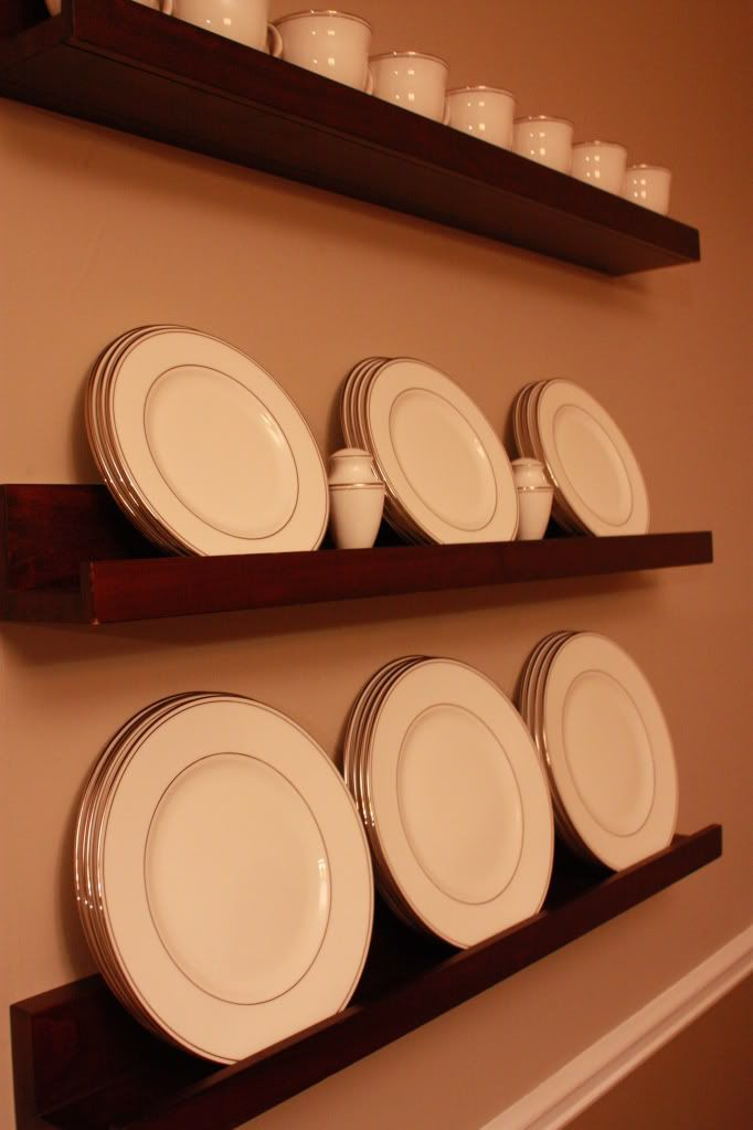 Use picture ledge to display china in kitchen?  (Ikea or Pottery Barn makes ledges that should work)