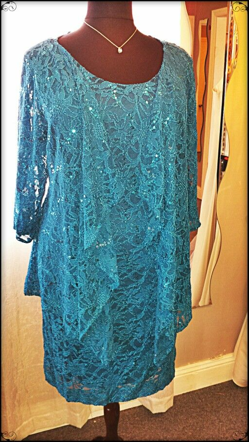 A sophisticated look for a plus - size mother of the bride. Two pieces, dress and jacket in Caribbean lace.